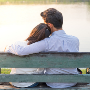 Sad couple on park bench after miscarriage